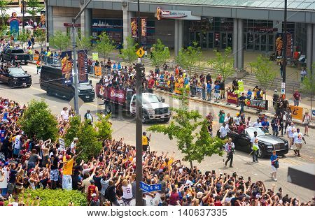 CLEVELAND OH - JUNE 22 2016: LeBron James (in yellow baseball cap) rides with his family past cheering crowds in the Cavs' NBA championship parade.