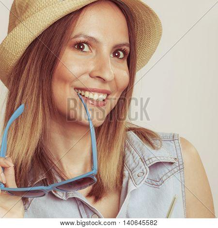 Flirty Seductive Woman In Hat Holding Sunglasses