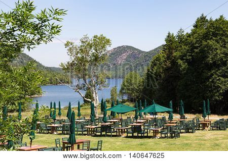 Outdoor dining area over looking Jordan Pond at Acadia National Park in Maine. Image shot before restaurant opened.