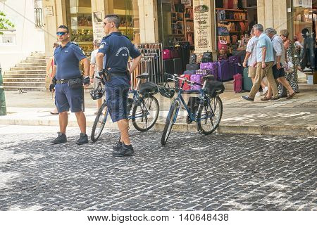 CORFU GREECE - June 11 2016. Police officers keeping a close and careful eye on people on the streets