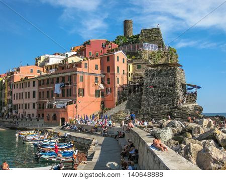 Vernazza, Ligurian Coast, Italy - June 4, 2010: Boats and tourists in Vernazza Harbor the most popular village of the Cinque Terre National Park, Unesco Heritage.