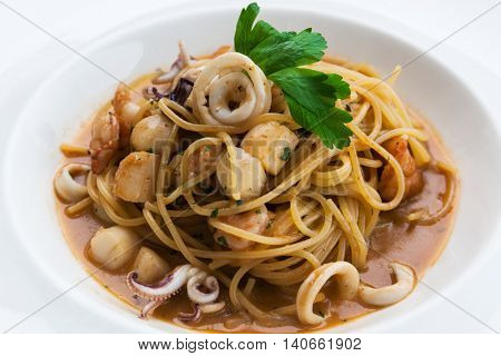 white plate with pasta and seafood