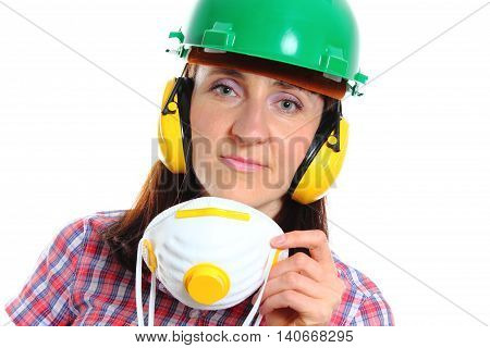 Female construction worker with protective mask wearing green helmet and protective headphones safety at work and ear protection. White background