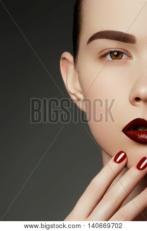 Red Sexy Lips And Nails Closeup. Open Mouth. Manicure And Makeup