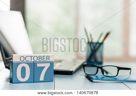 October 7th. Day 7 of month, calendar on CEO workplace background. Autumn time. Empty space for text.