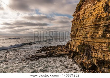 Ocean, cliff and rocks at Sunset Cliffs in San Diego, California.