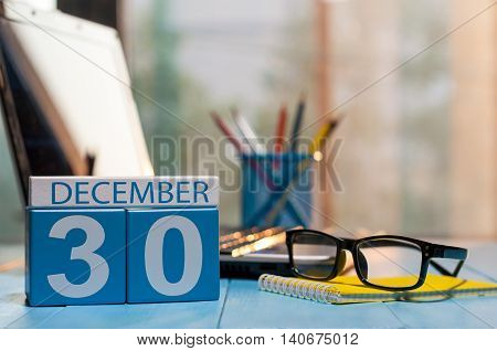December 30th. Day 30 of month, calendar on white-collar worker workplace background. New year at work concept. Winter time. Empty space for text.
