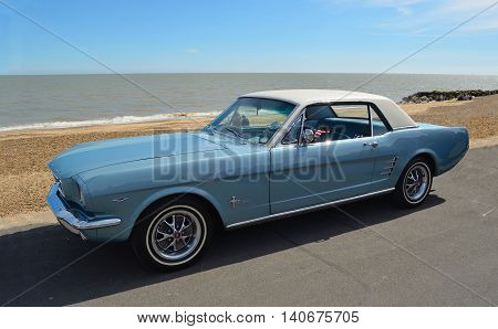 FELIXSTOWE, SUFFOLK, ENGLAND - MAY 01, 2016: Classic Blue Ford Mustang motor car parked on  Felixstowe seafront promenade.