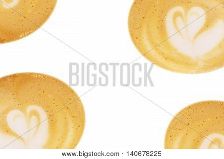 Close-up of coffee foam heart or flower art isolated over a white background with copy space