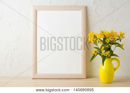Frame mockup with yellow flowers in stylized pitcher vase . Poster white frame mockup. Empty white frame mockup for presentation design.