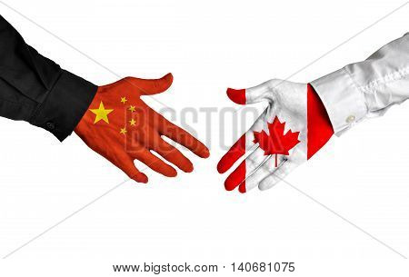 China and Canada leaders shaking hands on a deal agreement