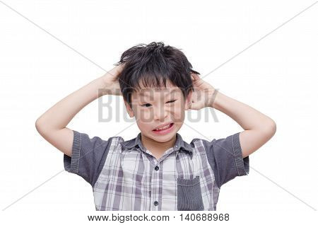 Young Asian boy scratching his scalp over white