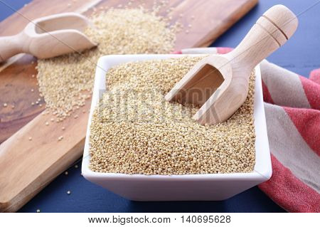 White Grain Quinoa On Blue Wood Background.