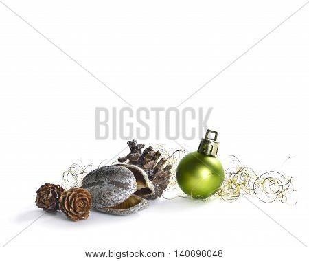 Christmas table decoration with pine cone and christmas tree balls, isolated on White