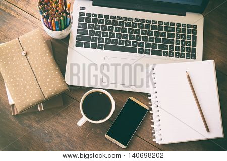 Business accessory. Laptop and smart phone for working business project on wooden table. You can apply for business background,business backdrop and business wallpaper including website decor.