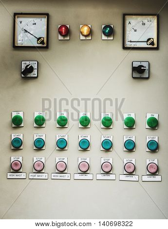 Old switchboard industrial light control with many buttons