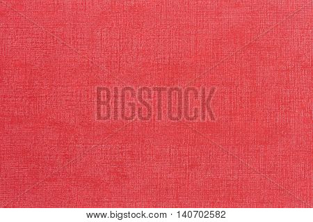 Red decorative leatherette texture background, close up