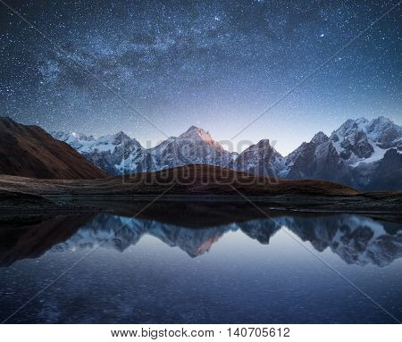 Night sky with stars and the Milky Way over a mountain lake. Collage of two frames. Art processing photos poster