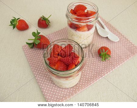 Homemade overnight oats with strawberries in jars
