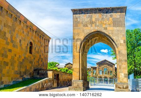 The view on the Veharan Pontifical Residence through the tuff arch in Mother See of Holy Etchmiadzin Vagharshapat Armenia.