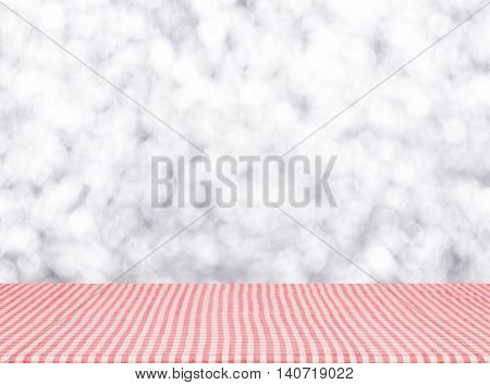 Empty red tablecloth material wooden deck tablecloth with blurred abstract background. for product display montage.