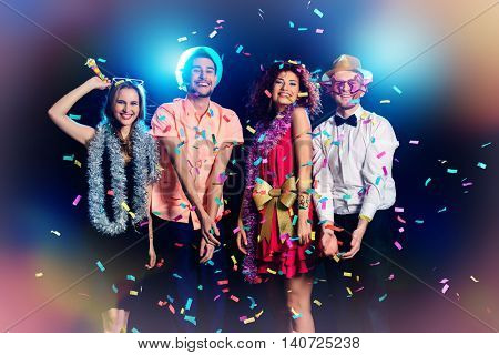 Group of cheerful friends having fun on a party. Holidays, celebration.