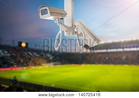 CCTV camera stadium football on twilight background. poster