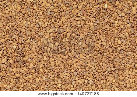 Organic Cinnamon (Cinnamomum verum) in tea cut size. Macro close up background texture. Top view.