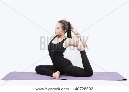 portrait of young asian woman exercise playing yoga isolated white