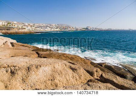 Scenic volcanic coast and perspective shoreline of Costa Adeje resort Tenerife Canary islands Spain