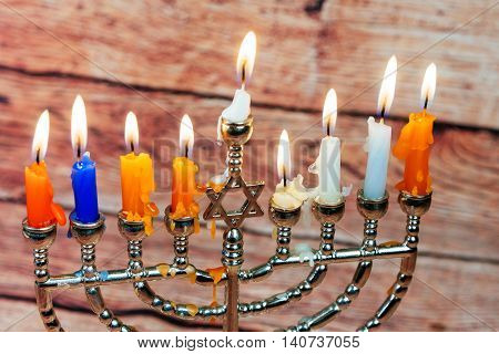 Image of jewish holiday Hanukkah background with menorah traditional candelabra Burning candles menorah, hanuka