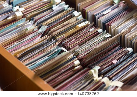 File folders in a file cabinet card catalog in a library closeup poster