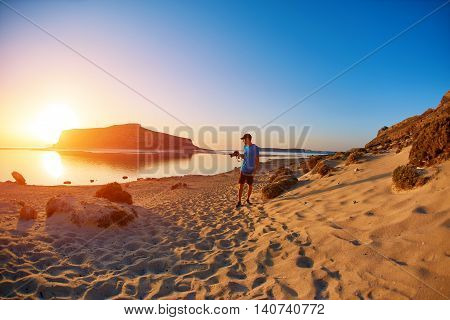panoramic view on Balos beach, Crete, Greece. Man, traveller and photographer runss on the beach