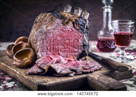 Rib of Beef with Yorshires on Cutting Board