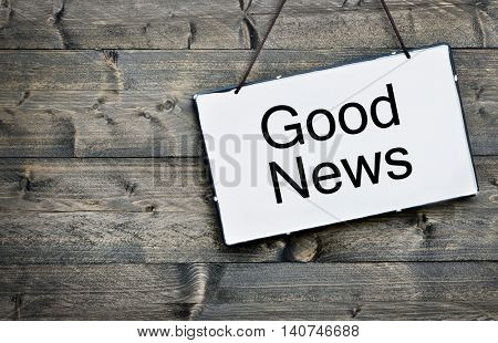 Good News message on wooden table
