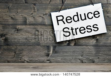 Reduce Stress message on wooden table