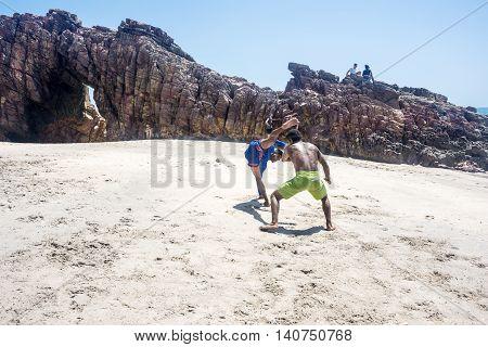 Jericoacoara Ceara state Brazil - July 19 2016: Brazilian capoeiristas performing at the famous Pedra Furada Beach