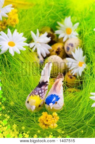 Nest with quail's eggs and birds among flowers poster