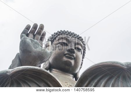 Tian Tan Buddha and bright white sky in sunny day in Hong Kong.