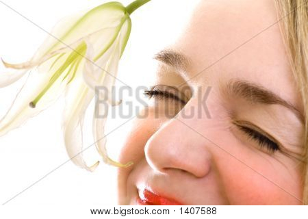 Smiling Female Face Close-Up With Lily