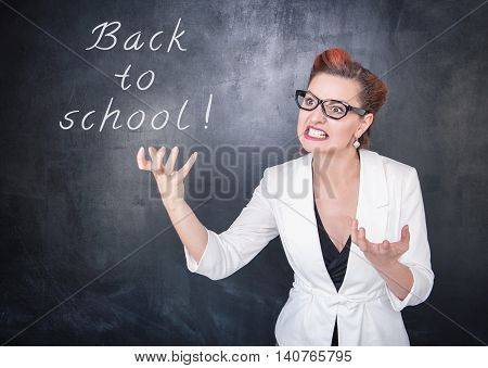 Angry Teacher In Glasses On Chalkboard Background