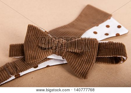 Brown Bow Tie On Kraft Background