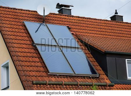 Solar panels on the red house roof. Close up photo.
