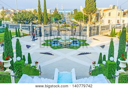 HAIFA ISRAEL - FEBRUARY 20 2016: The square with fountains and flower beds in lower Bahai Gardens on February 20 in Haifa.