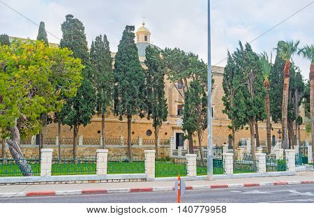 The Stella Maris Monastery located on Mount Carmel and surrounded by green garden Haifa Israel.