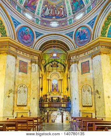 HAIFA ISRAEL - FEBRUARY 20 2016: The prayer hall of Stella Maris Monastery located on the Carmel Mount with the cave at the altar on February 20 in Haifa.