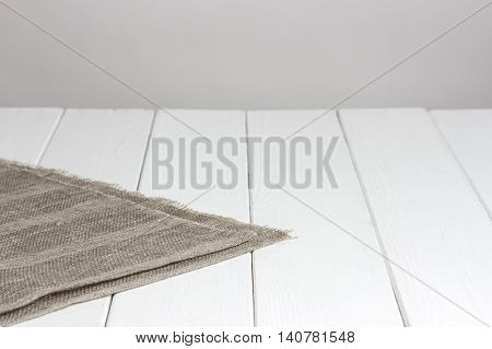 White wooden table with tablecloth, background for the product montage