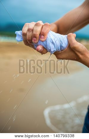 Hands Wring Out A Wet Cloth