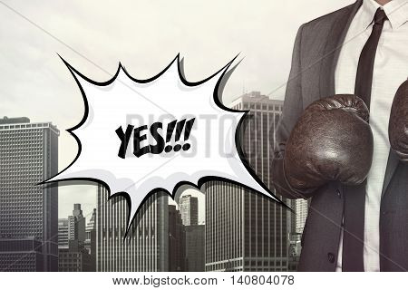 Yes text on speech bubble with businessman wearing boxing gloves