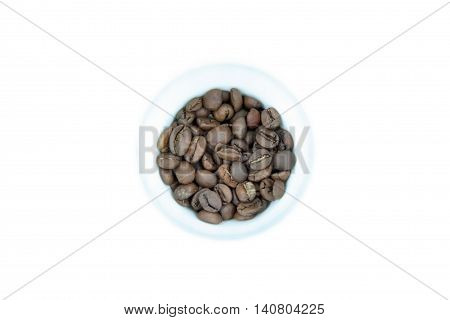 White cup of coffee with coffee beans.